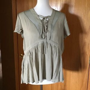 Fun summer lace up top! Light green.Sizes; S, M, L